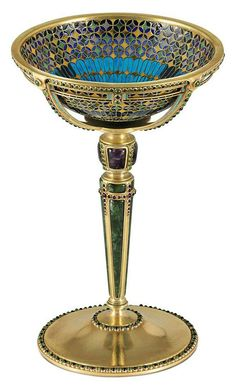 AN IMPORTANT GOLD, PLIQUE-A-JOUR ENAMEL, AND GEM-SET CUP DESIGNED BY LOUIS COMFORT TIFFANY MARK OF TIFFANY & CO., NEW YORK, 1916.