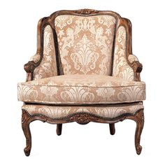 Upholstered arm chair with a walnut finish and carved detail.     Product: Arm chairConstruction Material: Wood and fa...