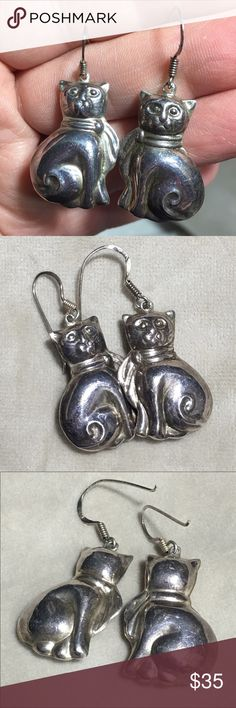 "🐈 Sterling Silver Kitty Cat w/ Scarf Earrings Ahh! These earrings are so insanely cute! They are like the Harry Potter of cats. Or better yet, Sherlock Holmes. No wait, the Fourth Doctor! Why do all of the best heroes wear scarves?  Anyway, I digress... these sterling silver cat earrings will definitely save your day (heh). They are puffy, hollow cats with scarves, dangling, on fishhook style ear hooks. Ear hooks are marked 925. Measurements: 1"" X 1"" Condition: Good, minor tarnishing…"