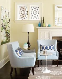 the light blue chairs and pillows are adorable!