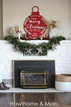 Christmas mantel ideas.  I love that giant ornament!