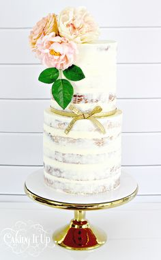 Simple semi naked cake featuring large blooms. www.facebook.com/cakingitup