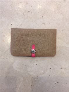 """Hermes """"dogon"""" Wallet Original price $2075- Bi-color Etoupe grey and hot pink color .Togo Calfskin leather with lamb skin leather lining and silver hardware. Soft and buttery. 4.9""""/ 7.9"""" with """"clou de selle"""" silver/ palladium leather strap closure. Please call  (949) 715 -0004 for all inquiries.#musthave #Hermes #softand buttery #lagunabeach #consighment"""