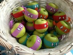 Cute picture of TMNT apples, no instructions,  just cut up piece of colorful streamers to fit around apple, tape and put eye stickers or cut up eyes and tape to streamers