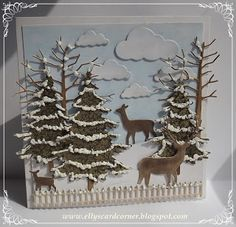 card with wonderful winter scene done in die cuts: clouds, bare branch trees, evergreen trees and deer...
