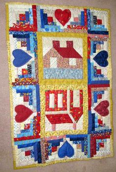 Schoolhouse Cottage Log Cabin Quilt, really like the log cabin border
