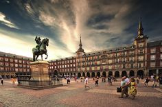 Plaza Mayor is an elegant arcaded square, topped with the Hapsburgs' black slate roofs and spindly pagoda-like towers. The plaza was completed in 1620 for Felipe III,his statue -also from the 17th century- graces its center. Madrid.