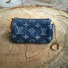 """Authentic Louis Vuitton Denim Key Pouch *Reposhing* an authentic Louis Vuitton denim key pouch. I love this piece so much (it was my first purchase on Poshmark!) but I hardly use it since I received a different key pouch that matches my go-to bag from my husband! It can fit credit cards, lip gloss/chapstick and other small accessories - it cannot hold a phone. It's 4.5"""" in width. No trades. No PayPal. No asking for lowest price  Louis Vuitton Accessories Key & Card Holders"""