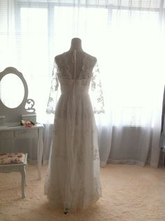 back - Vintage Lace Wedding Dress Bridal Gown Deep front back V Neck Open Back Long Lace sleeves A LINE Dress. $476.00, via Etsy.