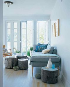 Tree stumps, used individually or clustered together, function as low tables in a living room. A coat of enamel paint applied to the tops serves a dual purpose: It adds a jolt of color and creates a smooth, sealed surface. Furniture gliders can be attached to protect the floor.