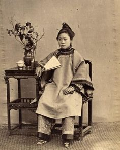 Vintage photograph of a woman with bound feet.