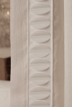 Add modern detail to draperies, pillows and upholstery with the Elliptic Applique Border from Samuel and Sons.