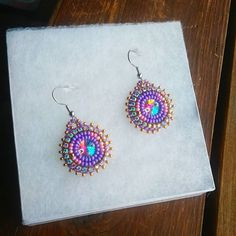 Not the best picture But made these small cuties for an order #beadwork #beadedearrings #nativebeadwork #earrings #jewelry #handmade #swarovski