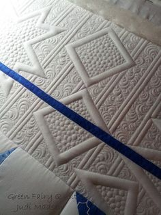 Lovely trapunto effect with modern free motion quilting
