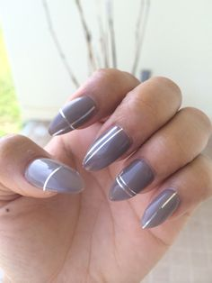 Almond shape / grey nails with silver pin stripe