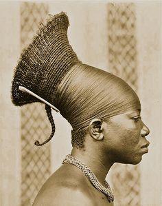 Mangbetu woman photographed in Chief Okondo's village, Congo, May 1913.