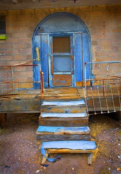 Blue door of the abandoned train depot at the ghost town of Rhyolite, Nevada, just outside Death Valley National Park~ Abandoned Train, Abandoned Buildings, Abandoned Places, Old Doors, Windows And Doors, Entry Doors, Portal, When One Door Closes, Death Valley National Park