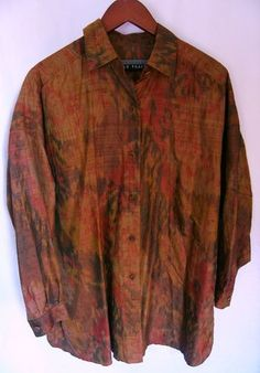 This is a gently worn Linda Allard Ellen Tracy green brown red long sleeve Plus 3X Women's Top Blouse. This is a designer top from Macy's. This top has beautiful autumn colors, brown, green, red. There are six brown buttons up the front. The sleeves are long and have a button on each cuff. This would be an incredibly comfortable top. The fabric is lightweight with a beautiful abstract pattern.