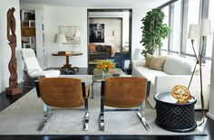 David Scott. Love these brown chairs for the living room.