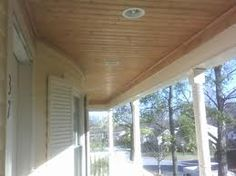 Shiny Natural Wood Tongue And Groove Porch Ceiling With Recessed Lights.  Perfect. Also