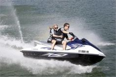 Invite your daring side to Green Lake with a ride on an Action Marina waverunner rental.