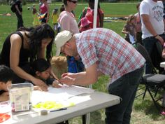 """Cooper's Crossing Residents' Society organized a fun and interactive """"Kite Day"""" in the park - building keep sake kites was part of the fun. www.cooperscrossing.ca #coopersairdrie"""