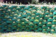 If you have lot of car tires, you can make a wall of tires. Arrange the tires as the image, color them in your favorite colors and fill them with soil and plant different kinds of plants.