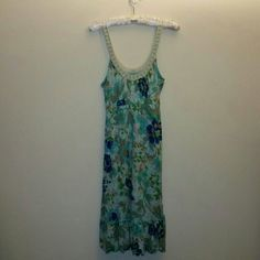 SALE Free People floral dress with beaded straps Free People blue and green floral dress with beads accented along the neckline and string ties under the bust, along an elastic empire waistband. There is a slight ruffle design along the bottom which can be seen in the last photo. Worn but in perfect condition. Free People Dresses
