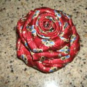 Raid your husband's closet for silk ties he no longer wears and create beautiful silk rose pins from them. You can also purchase them for $1.00 each at Goodwill. Wear them on a blazer, pin on a tote bag or purse, or use to embellish a pillow. The possibilities are endless!