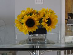 Sunflowers in a Square Vase