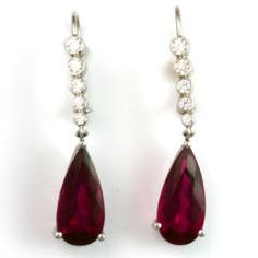 The Rare, rich magenta of these pear shape #RubelliteTourmalines (6.11 ct total) creates the focal point on the ear, dangling from a row of fine white diamonds (0.43 ct total)
