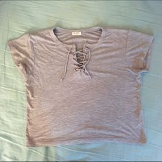 Brandy Melville Gray Lace Up Top Brandy Melville. Perfect condition. Worn once or twice. Soft gray knit material. Criss cross lace up design. Brandy Melville Tops