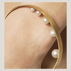 "Bangle | Lia Di Gregorio Gioielli.  ""Light"".  18k gold and pearls"