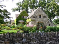 ROSE COTTAGE | The oldest building in Greenfield Village was imported from England's Cotswold Hills to represent the area from which Henry Ford's ancestors immigrated. It is surrounded by a lush country garden.