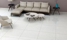 One can easily tell the two kinds apart. Ceramics are made using earthen clay and have coarser texture while vitrified tiles are made using clay and silica and have glossy look. Find the best double charged vitrified tiles at Vitero. Vitrified Tiles, Glossier Look, Class Design, Tile Design, Living Room Designs, Tile Floor, Two By Two, Clay, Couch