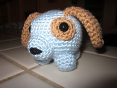 I always thought the Roly Poly Cats pattern by Nina Shimizu were super cute, but I wanted a dog version to make for boy babies. So I made this pattern up. I also put a cat toy inside when I stuffed him so he rattles. :)