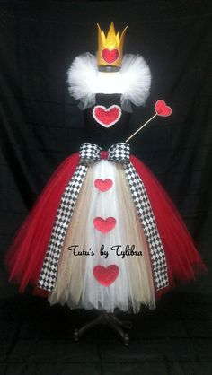 This adorable Heart Queen tutu dress is great for an Alice in Wonderland theme party, halloween costume or just for fun! This tutu dress is made with a black stretch crochet tube top then I add layers of fluffy red, white and gold tulle with glitter tulle mixed throughout - just to add some sparkle. A white tulle collar (attached with Velcro so it can be adjusted or removed) and a red glitter heart with pearl trim embellishment on the top along with red glitter heart embellishments on the…