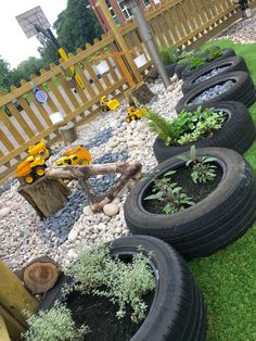 Outdoor learning. Sensory/herb garden in recycled tyres, pebble pit with weighing scales and diggers. Construction area