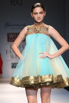 #wifw #fdci #wifwss15 #wlifw #fashionwear #designerwear #invogue #bhanuni #jyoti #fashionweek #red #gold #sheer #blue #pleats #flare #aqua #border #gowns #pleatedskirts #skirts #flaredskirts #ruffles