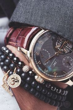 Beaded cultural bracelets layered up with a great watch.