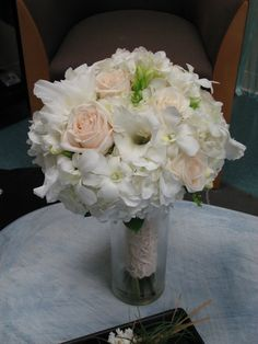A beautiful bride's bouquet in all white and ivory flowers by Pamela for Michael's Flower Girl
