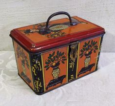 Done in orange, the lid is decorated with an Asian woman or geisha, with vases of flowers or fruit all around the base, along with Asian writing symbols. Handle on lid and latch at front make things extra special. | eBay!