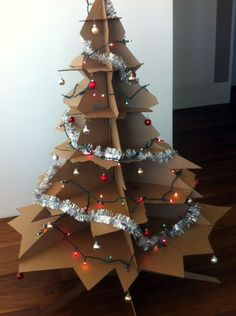 Cardboard Christmas Tree,  http://www.instructables.com/id/Cardboard-Christmas-Tree-1/?ALLSTEPS.