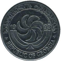 1 Tetri #Georgia - 1993  Rappresenta il Borjgali, simbolo georgiano del sole con 7 ali rotanti e l'albero della vita, un simbolo della religione cristiana.
