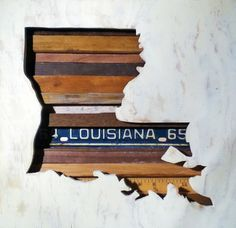 'Louisiana' by Kevin Stinehart, made of salvaged wood and a license plate. Part of our collection! Louisiana Mardi Gras, Louisiana Homes, Louisiana Art, City Under The Sea, Southern Hospitality, Southern Charm, Southern Living, Map Projects, Reclaimed Wood Art