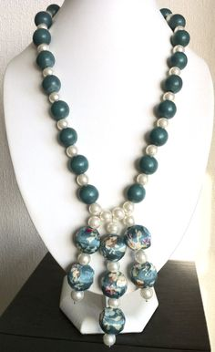 Teal wood & ivory glass pearl necklace with floral drop beads. For the pendants/fringe(?)