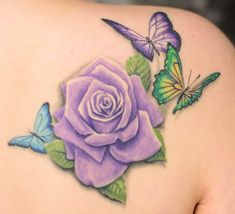 Purple rose tattoo with butterflies. For my daughter, her birth flower is a rose. Her signature color is purple. Butterflies like her bedroom, in the color palette of her room.