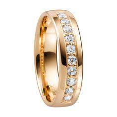 DIAMOND RING in 18K gold, ArtNr:  0333229 BRAND. Schalins Diamonds 10 Total Carat. 0,30 Quality: WSI  Width: (MM) 5 Height: (MM) 1,5 Weight: Ca (GRAM) 5,5 Buy at: Hallbergs Guld, Kristianstad, Sweden