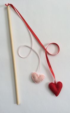 Handmade Wand Heart Set Catnip Cat Toy Stick Toy with String Ribbon by VTcatniptoys on Etsy https://www.etsy.com/listing/225546657/handmade-wand-heart-set-catnip-cat-toy