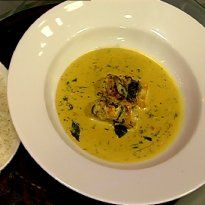 Meen Moilee with Steamed Rice Recipe - Kerala style fish in coconut curry, flavored with green chilli, curry leaves and turmeric. Served with steamed rice.